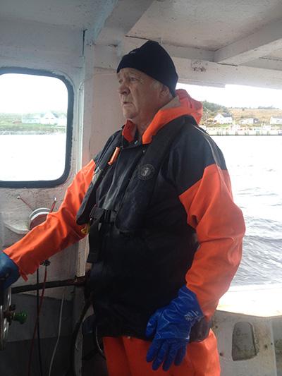 Eugene onboard his lobster boat — Light Winds.