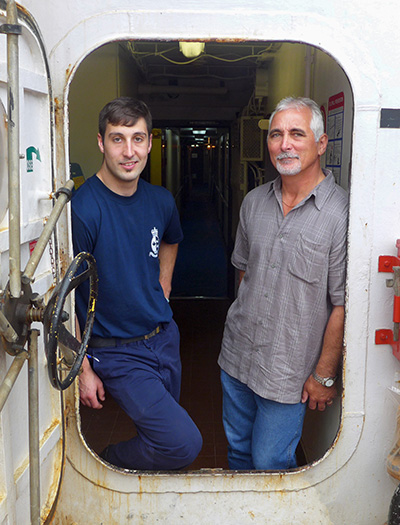 Captain Windross Banton, of the CCGS Terry Fox, visits his son Blair Banton onboard the CCGS Ann Harvey.