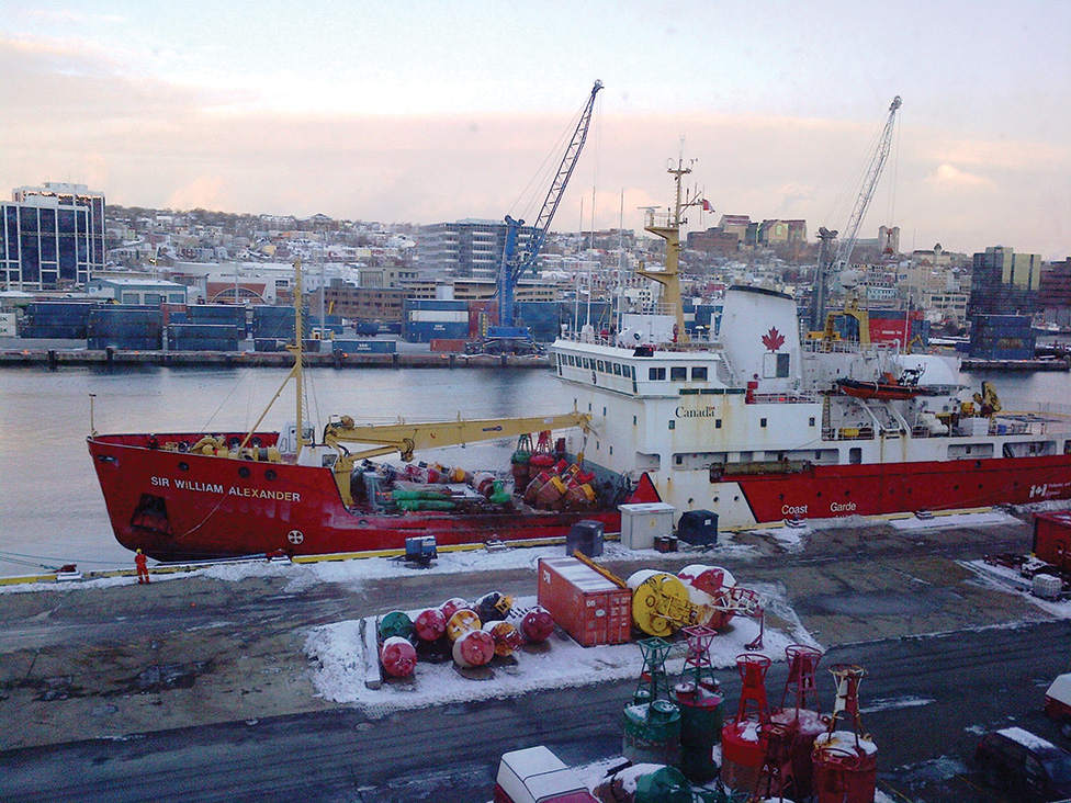 A crane lifts buoys onto CCGS Sir William Alexander from the yard at the St. John's base.