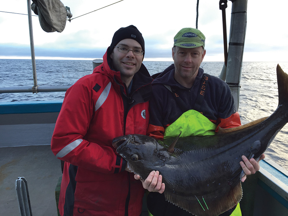Dr. Dominique Robert (Centre for Fisheries Ecosystems Research) and Dr. Tim Loher (International Pacific Halibut Commission) with an Atlantic halibut carrying two conventional tags and one satellite tag.