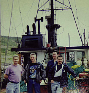 Max Forsey and his brothers Bill, Wayne and Simeon on the deck of the Fortune Pride, a steel ship Max Forsey had built in 1989. Submitted photo